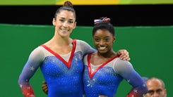 Aug 16, 2016; Rio de Janeiro, Brazil; Simone Biles (USA) and Aly Raisman (USA) celebrate after winning a medal during to the women's floor exercise final in the Rio 2016 Summer Olympic Games at Rio Olympic Arena. Mandatory Credit: Robert Deutsch-USA TODAY Sports ORG XMIT: USATSI-GRP-950 ORIG FILE ID:  20160816_ads_usa_382.JPG