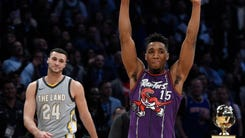 Donovan Mitchell celebrating after beating Larry Nance