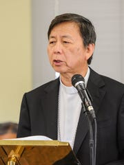 Archbishop Savio Hon Tai Fai speaks during a press