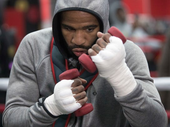 Lamont Peterson warms up during a workout at Gleason's Gym, Wednesday, Jan. 17, 2018, in the Brooklyn borough of New York. Peterson faces Errol Spence Jr. on Saturday in Brooklyn, for Spence's IBF welterweight title. (AP Photo/Mary Altaffer)
