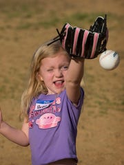 Brylee Speicher, 3, of Elberfeld, Ind., makes a stab at a soft tee ball her coach (and dad) Bryce Speicher tossed to her at the team's second practice of the season at Kiwanis Park in Elberfeld Thursday evening.