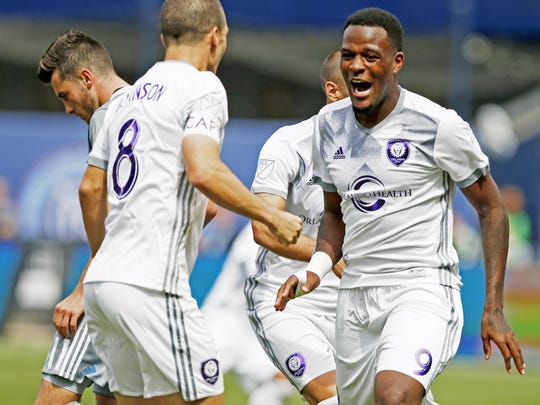 Orlando City SC forward Cyle Larin (9) reacts with Orlando City SC forward Will Johnson (8) after scoring a goal during the second half of an MLS soccer game against the New York City FC, Sunday, April 23, 2017, in New York. Orlando defeated New York 2-1.