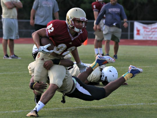 Riverdale receiver K.J. Crawford tries to shed a Bradley