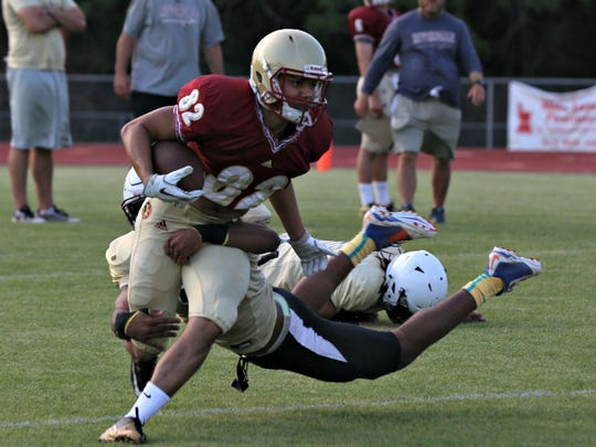 Riverdale receiver K.J. Crawford tries to shed a Bradley Central tackler during Thursday's scrimmage.