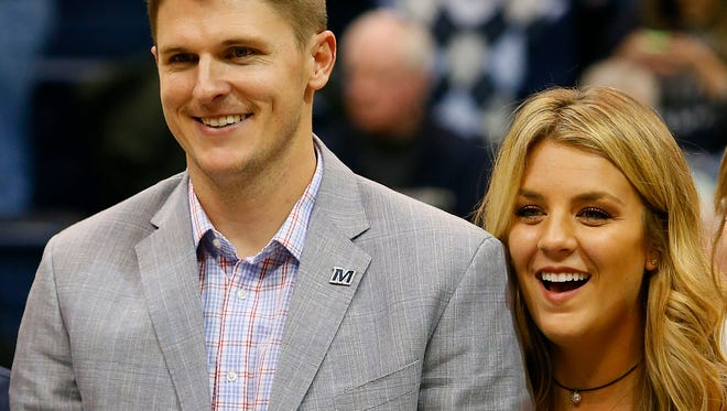Brad Brock and wife during halftime ceremony at OceanFirst Bank Center, West Long Branch,NJ. Saturday, December 10, 2016. Noah K. Murray-Correspondent/Asbury Park Press ASB 1211 Monmouth Basketball