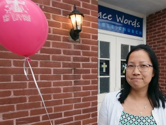 Caroline Jiang, of Grace Words Bible Church, describes how church members and volunteers attached 1000 balloons to the fronts of houses at 3 a.m. Sunday, and how through the night, people kept coming to help. The church attached just 150 balloons last year.
