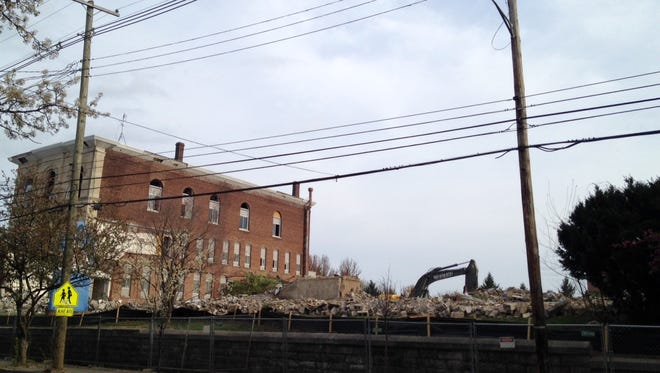 Much of the former Mercy Academy complex is reduced to rubble on March 30, after demolition recently began at the site on East Broadway.