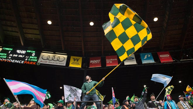 Portland Timbers fans celebrate after a game against the Colorado Rapids at Providence Park. The Timbers won 1-0. Mandatory Credit: Troy Wayrynen-USA TODAY Sports