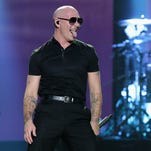 Recording artist Pitbull performs onstage at iHeartRadio Fiesta Latina presented by Sprint at American Airlines Arena on November 7, 2015 in Miami, Florida.
