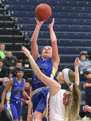Onatrio's Madeline Collins makes a jump shot while