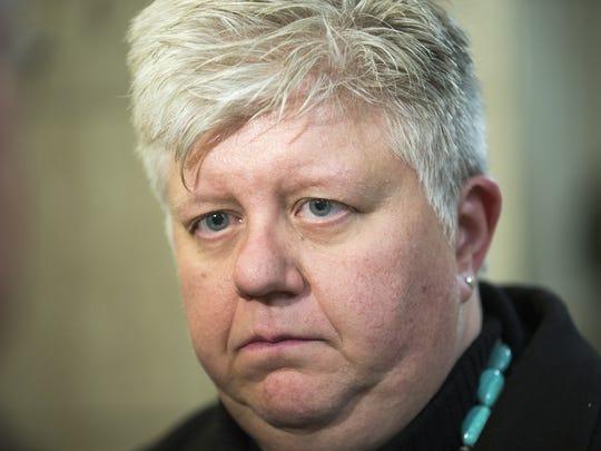 Deputy Prosecutor Denise Robinson speaks after the