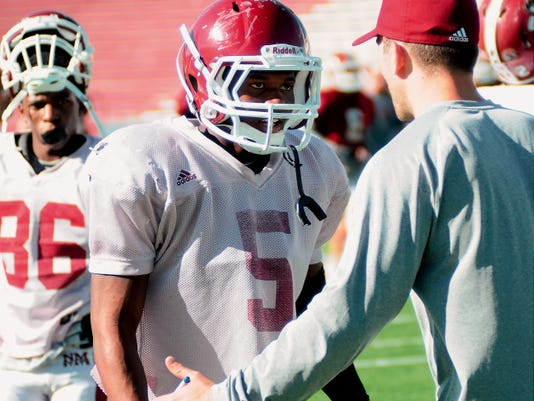 Robin Zielinski   Sun-News   New Mexico State receiver Tyrian Taylor talks to receivers coach Cory Martin during practice at Aggie Memorial Stadium. Taylor is a junior college transfer and Martin joined the staff of his father, Doug Martin, to coach the wide receivers this year.
