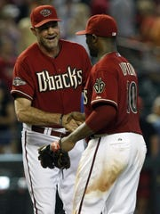 Kirk Gibson, left, congratulates Upton after a win in July 2011, when they were both with the Arizona Diamondbacks.