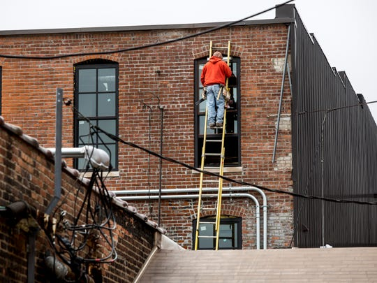 Windows are installed on the rear side of the J.J. Newberry lofts building Friday, March 18, 2016 in downtown Port Huron.