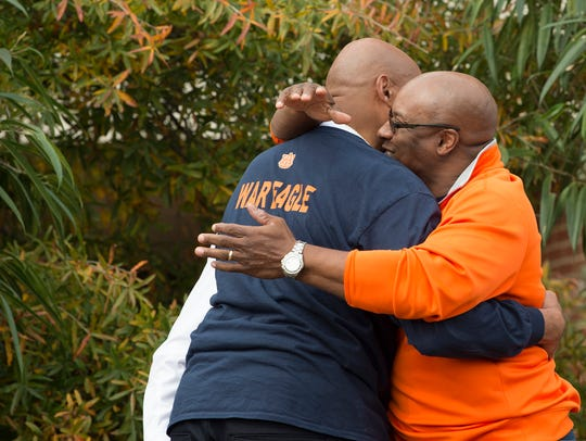 Bo Jackson, right, embraces Charles Barkley during