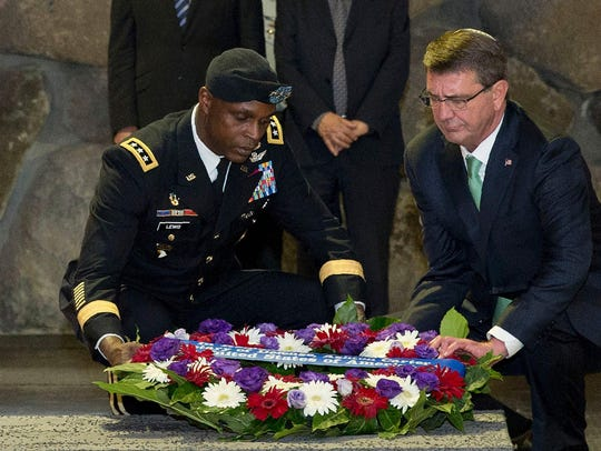Lt. Gen. Ron Lewis and then-Defense secretary Ash Carter