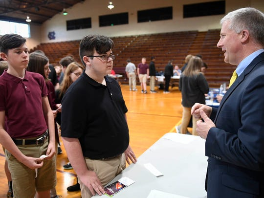 """Retired Henderson District Court Judge Rob  Wiederstein talks with North Middle School students Austin Denham, 13 years-old, (left) and Jesse Coghill during a role-playing exercise called """"Truth or Consequences"""" Wednesday, April 12, 2017."""