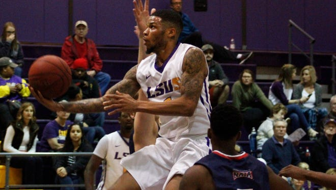 Benjamin Batts(1) flys through the middle of Southwest defenders to lay up the ball for LSUS on Thursday night at LSU Shreveport.