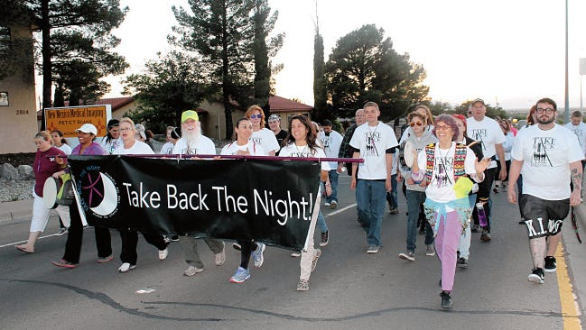 In this 2015 file photos Take Back the Night march participants walked along Scenic Drive and Indian Wells Road to take a stand against sexual assault and domestic violence in Alamogordo. This year Take Back the Night will be Friday between 6:30 p.m. and 9 p.m.
