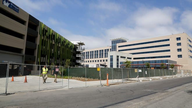 A midtown parking structure adjacent to the Community Memorial Hospital construction site in Ventura opened this week. The new hospital building is expected to open next summer.