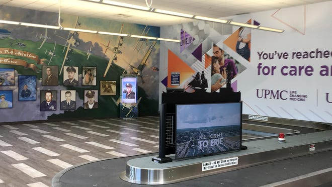 The Northwest Pennsylvania Aviation Wall of Fame mural, at left, has been restored to the east wall in the baggage claim area of the Erie International Airport. A UPMC Health Plan advertisement is now on the south wall, at right.