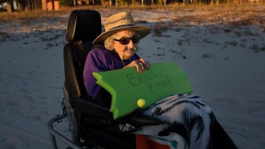 Ruby Holt, a 100-year-old Tennessee native, heads toward the beach for the first time in her life Wednesday, Nov. 19, 2014, in Orange Beach, Ala. The Brookdale Senior Living and Wish of a Lifetime organizations both provide Holt a wish of her choice. She chose to see the ocean for the first time. She said she'd never seen anything as big as the ocean.