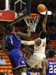 Trey Wade of UTEP reaches for a dunk against Louisiana