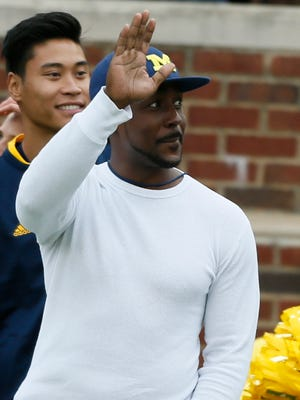 Former Michigan football player Desmon Howard waves to the crowd during a 35-7 win over Oregon State on Sept. 12, 2015, in Ann Arbor.