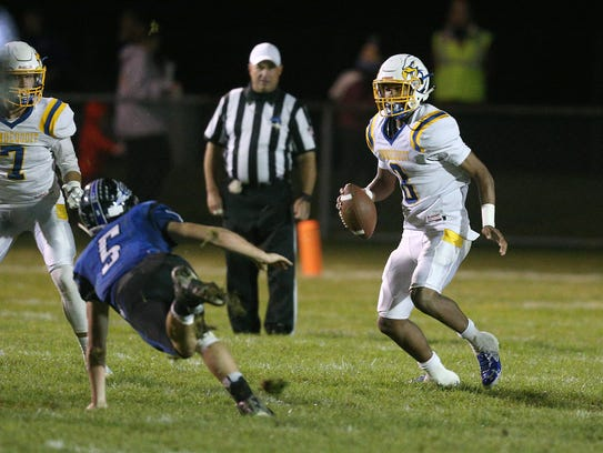 Irondequoit quarterback Freddy June Jr. (8) trying to get away from Brockport's Josh Keenan during the 2017 regular season.