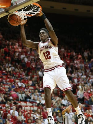 Indiana Hoosiers forward Hanner Mosquera-Perea follows through with a dunk but it didn't count as referees called a ten second violation against Indiana in action with the Greyhounds in the second half. Indiana hosted the University of Indianapolis in a preseason game at Assembly Hall on Monday, November 10, 2014.