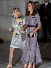 Duchess Kate of Cambridge arrives at the Victoria and Albert Museum in London wearing a belted Erdem maxi dress.
