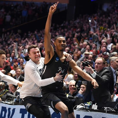 Wolf Pack guard Josh Hall reacts after defeating the