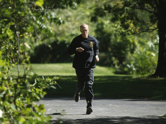 """Jason """"J-Mac"""" McElwain trains for his first marathon, the Rochester Marathon in 2012. He will be running the half marathon in Rochester on Sept. 20."""