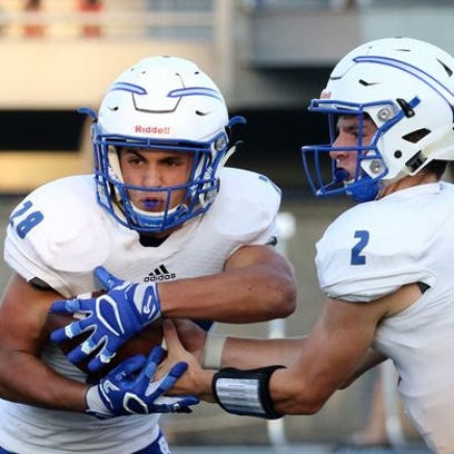 Brookfield Central's Drew Leszczynski (2) and Zach Heckman (28) combined for seven touchdowns against Hartford.