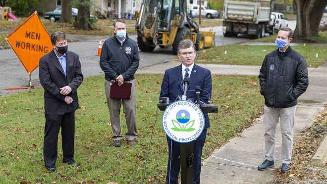 Springfield Mayor Jim Langfelder speaks about the city's project for replacing lead service lines to homes during a press conference with CWLP Water Division Manager Todd LaFountain, left, U.S. EPA Region 5 Administrator Kurt Thiede, and U.S. Rep. Rodney Davis, R-Taylorville, right, at the intersection of S. 15th St. and E. Stuart St., Tuesday, October 27, 2020, in Springfield, Ill. The U.S. Environmental Protection Agency announced more than $113 million to modernize water infrastructure in Illinois which is part of the Drinking Water State Revolving Loan Fund.