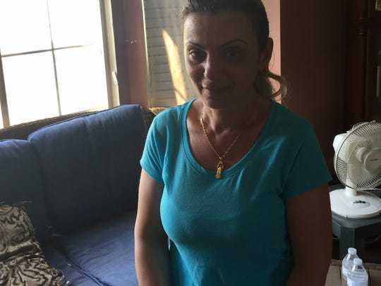 Lina Denha, of Sterling Heights, is concerned about