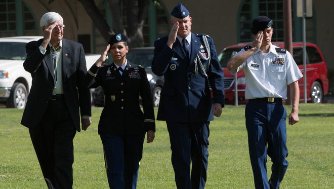 New Mexico State University Chancellor Garrey Carruthers, left, along with Army ROTC's Lt. Col Blanca Reyes, Air Force ROTC's Lt. Col. Jeremiah Klomp and Cadet Lt. Col Richard Buck review the NMSU ROTC units during the 115th Pass-in-Review at the Horseshoe, Thursday, April 13, 2017.