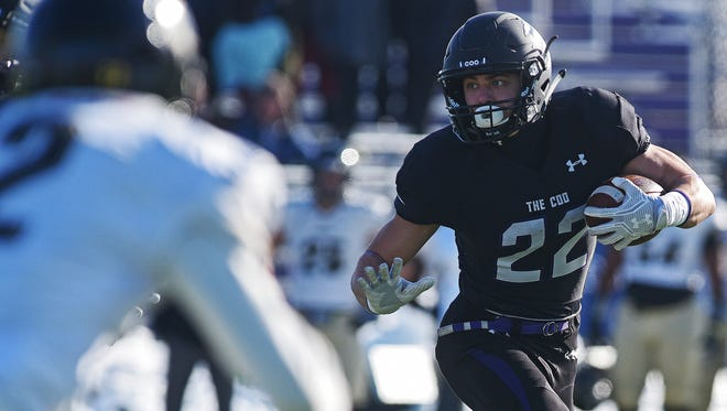 USF's Max Mickey (22) carries the ball during a NCAA Division II playoff game against Harding Saturday, Nov. 26, 2016, at Bob Young Field in Sioux Falls.