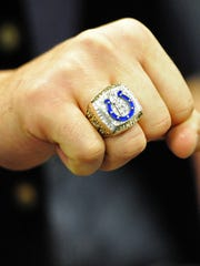 Former Indianapolis Colt Ben Utecht showed his Super Bowl ring to a fan in 2012.