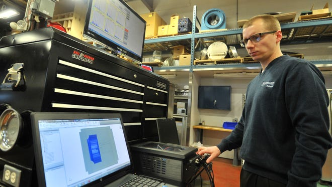 Product development engineering Nathan Fetting, 28, of Wausau, analyzes a product vibration test Thursday, April 2, 2015, at Greenheck Fan Corporation in Schofield.