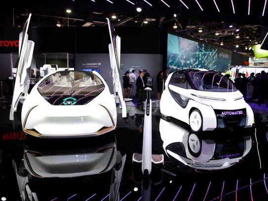 Toyota Concept-i Series vehicles appear on display