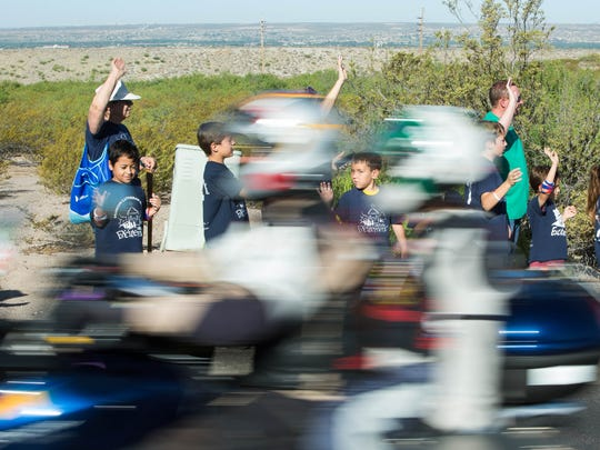 Students from Mission Lutheran School wave at motorcyclists Friday May 18, 2018, as they make their way to Veterans Memorial Park, a stop on the Run For The Wall, a 10-day trip from California to Washington D.C., made up of veterans and civilians wanting to honor prisoners of war and soldiers killed in action.
