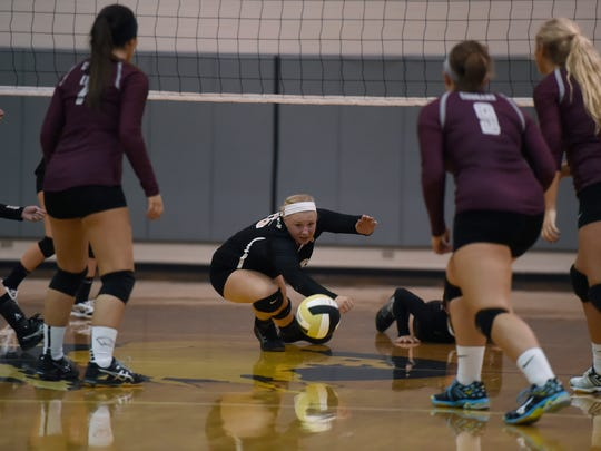 Buffalo Gap's Camille Ashby dives on the ground in an attempted return during their volleyball game against Stuarts Draft on Tuesday, Sept. 22, 2015.