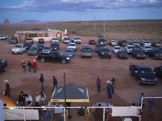 Spectators and contestants find parking in a dirt area near Ken Young's house for the15th Annual Kenny Young Bull Riding Classic in Page. Young built an arena for the event.