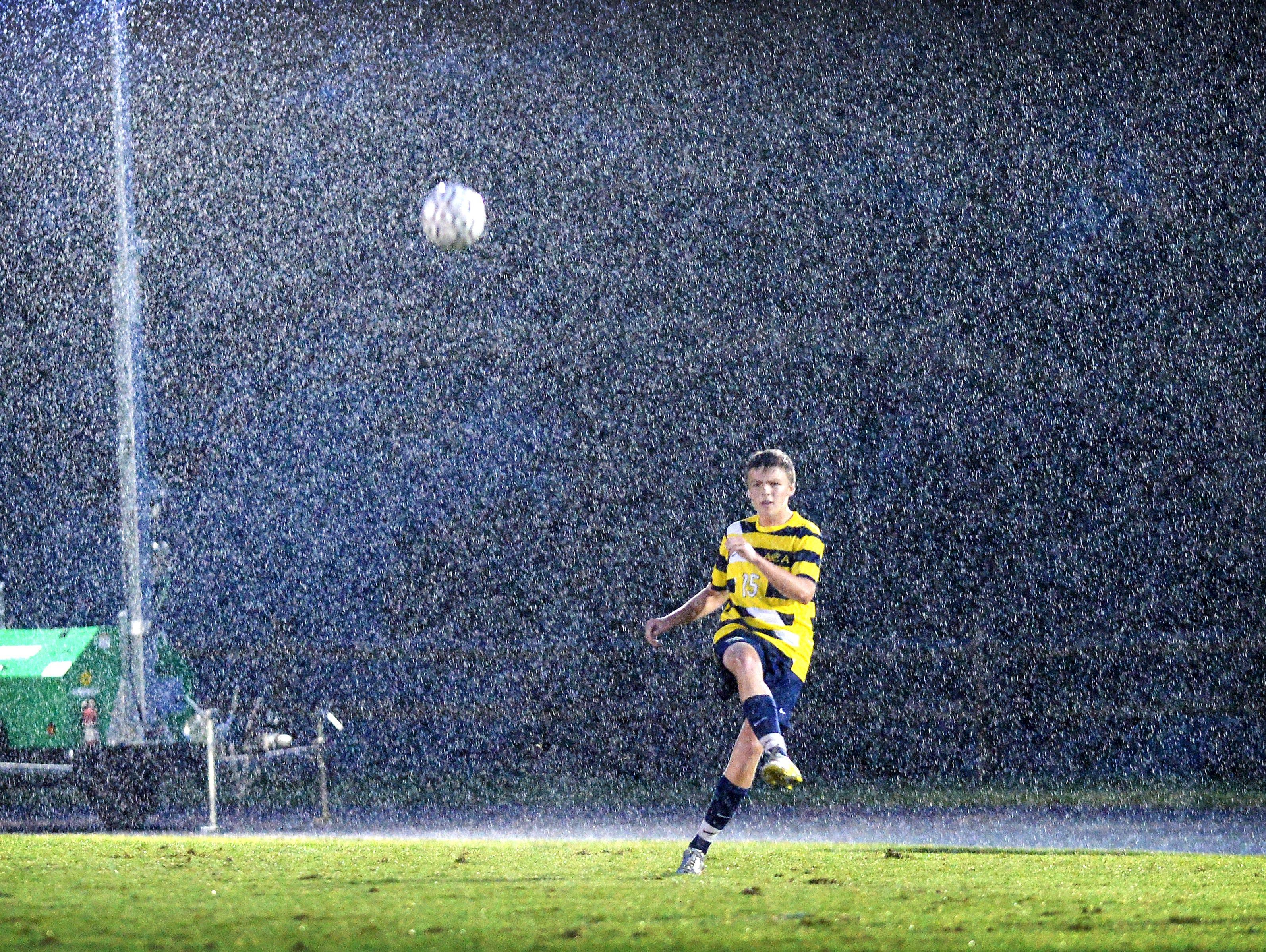 Asheville Christian Academy's Logan Whalen kicks a ball Thursday at Christ School.