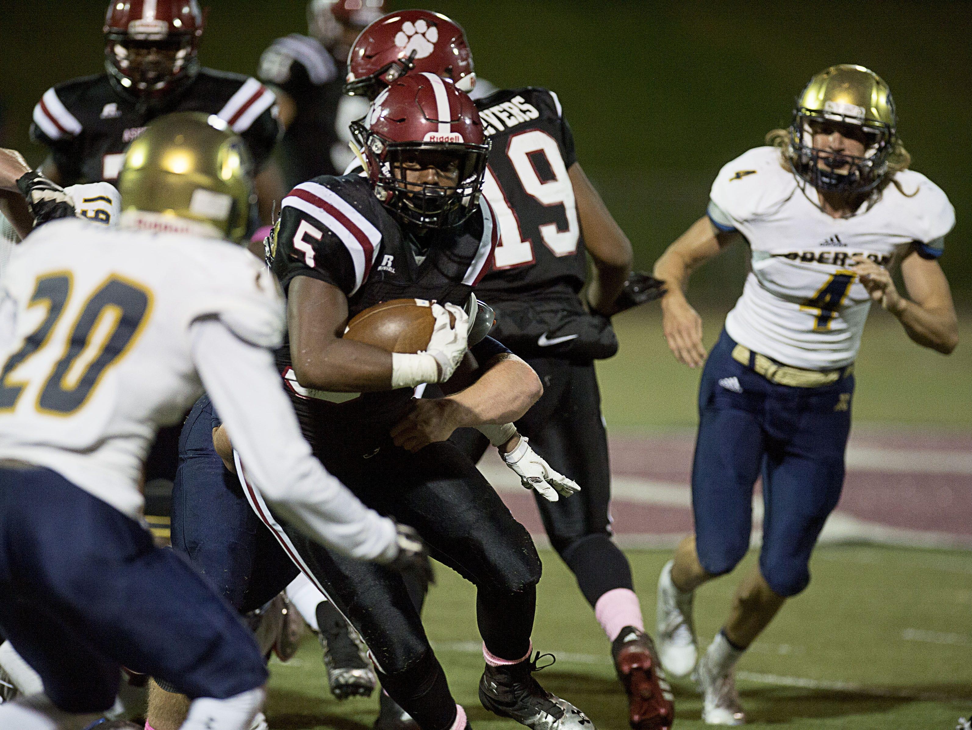 Asheville High's Reggie Battle weaves through the Roberson defense on Friday.