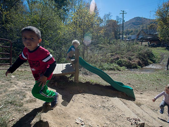 Kids play on a slide Wednesday October 21, 2015 at