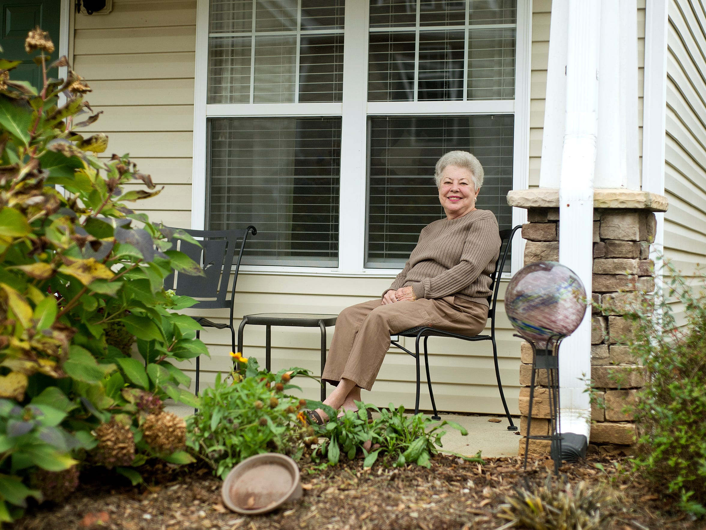 Patty Mewborne Head sits outside of the home she lives
