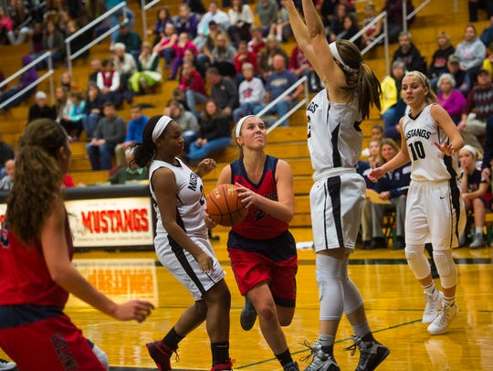 New Oxford's Kaelyn Long looks for an opening against