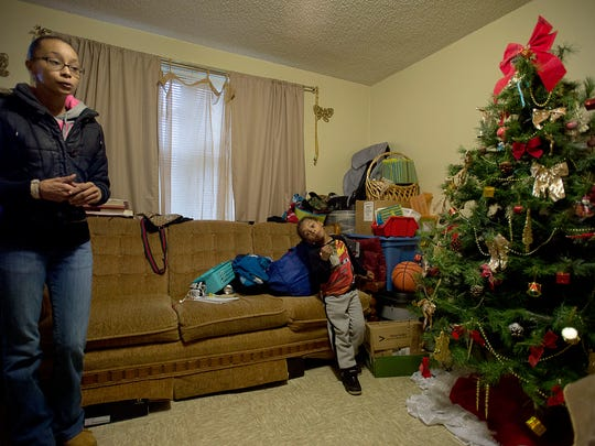 Maria Taylor, alongside her five-year-old son, Zyheim Ponder, talk about the potential for a new mixed-income development inside their home at Lee Walker Heights on Monday. In January, the Housing Authority for the City of Asheville intends to go before city council to share its plans to tear down and rebuild the city's oldest public housing development.